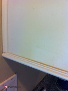 yellow stains on cabinets before